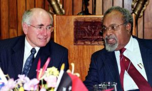 Sir Michael Somare speaking with Australian Prime Minister John Howard in 2002. Somare is credited with leading Papua New Guinea to its independence from Australia. Photograph: Rocky Roe/AFP